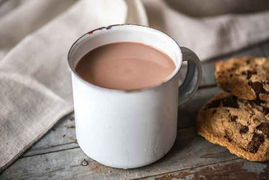 coffee cup beside biscuits